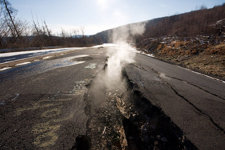 Steam rises from fissures on Centralia's old Route 61. Credit: Flickr/kaanah