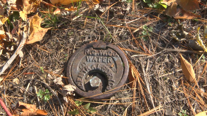 An old waterline cap along Railroad Avenue, marking the location of a former home.