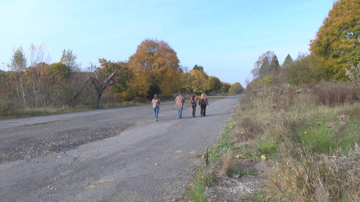 Volunteers walk down Railroad Avenue in Centralia after cleaning up trash from the wooded areas nearby.