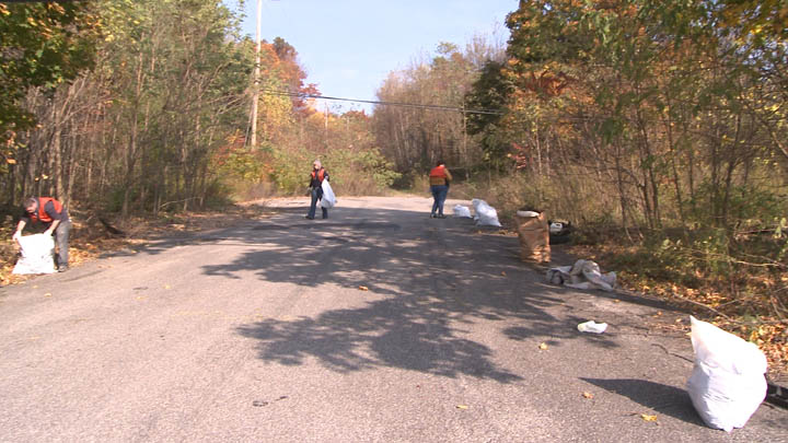 Volunteers cleanup trash along Trautwine Street in Centralia Pennsylvania.