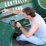 John Lokitis Jr. painting the Centralia PA bench in 2006. Credit: Flickr/letdown102