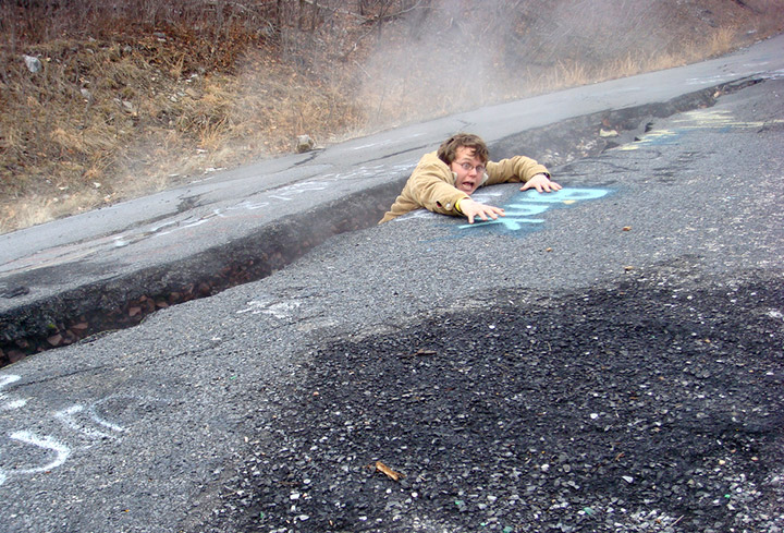 Falling into a fissure on old Route 61 in Centralia. Credit: Flickr/nicksherman